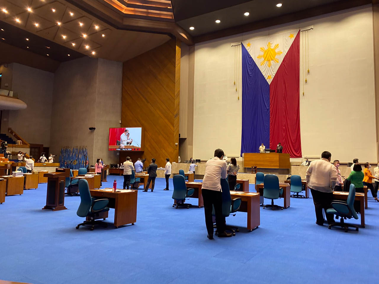 PHYSICAL DISTANCE. Congressmen's tables are spaced more than a meter apart as Congress resumes session. Photo from the Office of House Majority Leader Martin Romualdez