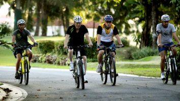 Noynoy Aquino biking in Bahay Pangarap