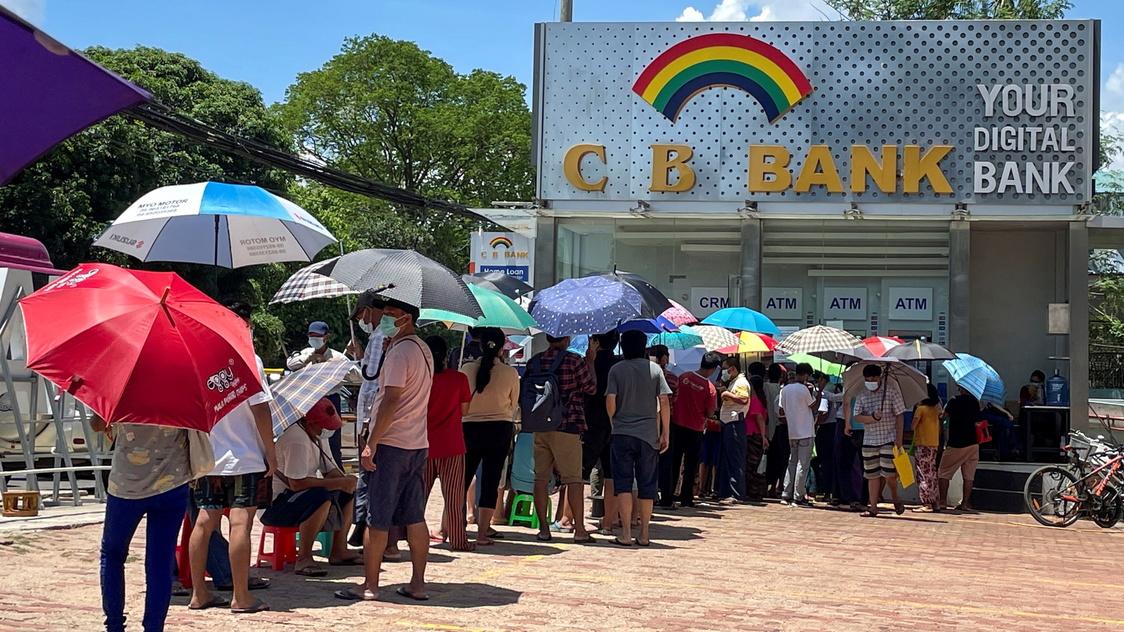rappler.com - Reuters - Lines, tokens, and money brokers: Myanmar's crumbling economy runs low on cash