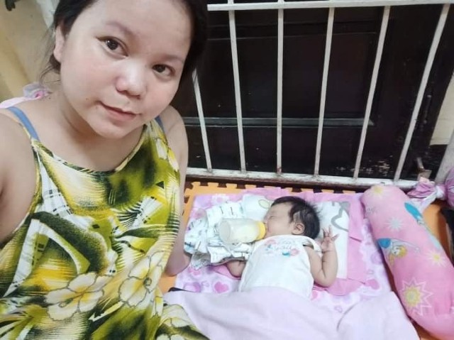 ONLY TWO MONTHS OLD. Roxane Serintas with her two-month-old baby inside an evacuation center. Photo from Serintas