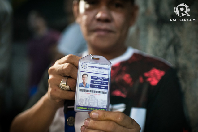 KIAN IS MY SON. Saldy delos Santos holds up his son's school ID, their only proper photo of Kian. Photo by Eloisa Lopez/Rappler
