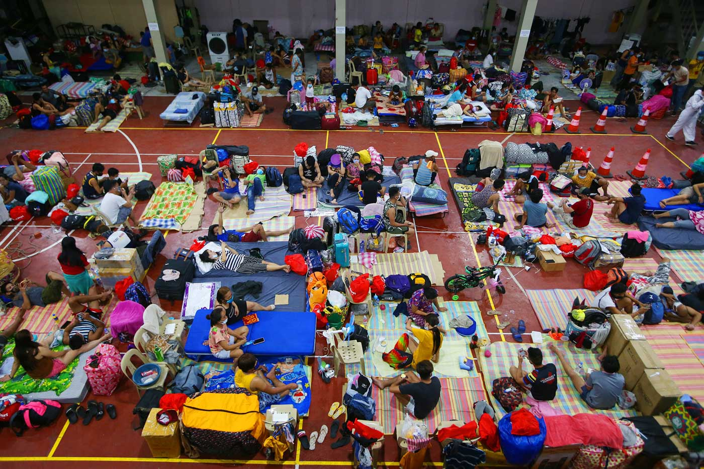 LIMBO. Stranded Filipinos camped outside of the Northport Passenger terminal are brought to the Philippine Ports Authority multi-purpose hall in Tondo, Manila on July 1, 2020 after their ferry trips bound for Visayas region were cancelled due to a surge of COVID19 cases. Photo by Inoue Jaena/Rappler