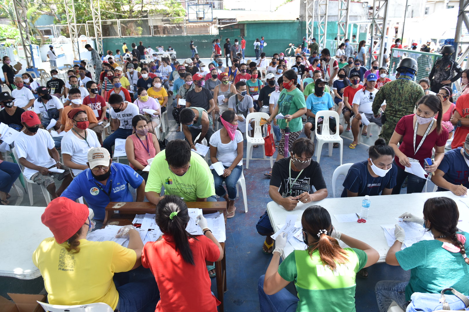 CAVITE. Residents of Barangay Pasong Camachile 1 in General Trias City crowd on Thursday, May 7, 2020 to receive their cash aid from the government's emergency subsidy program. Photo by Dennis Abrina