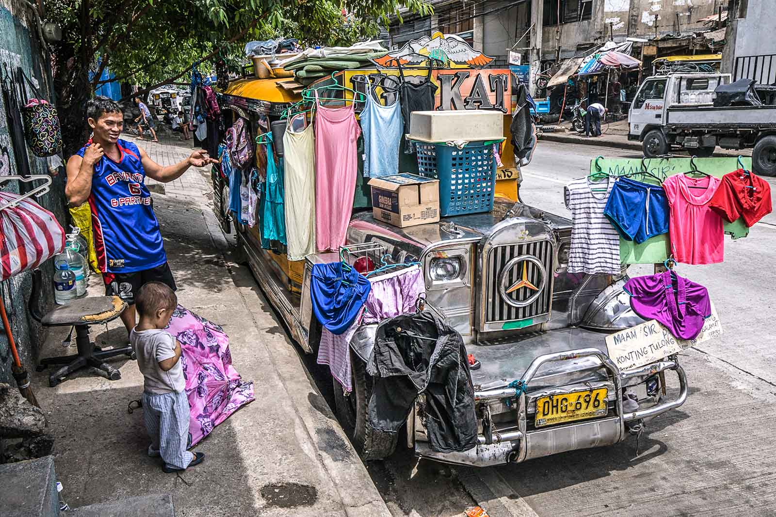 HARDEST HIT. After getting evicted from their residence in Tondo due to their failure to pay rent, jeepney driver Julius Evangelista and his family have lived inside their jeepney since the start of the Metro Manila lockdown. Photo by Darren Langit/Rappler