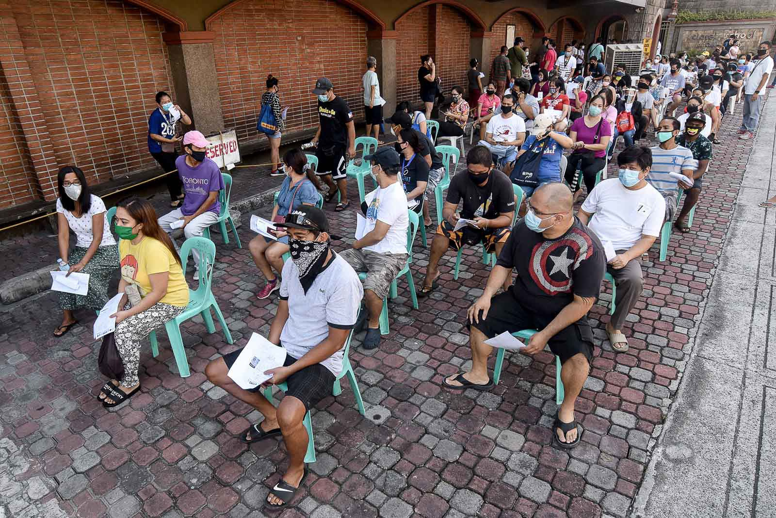 QUEZON CITY. Residents of Teachers Village East in Quezon City queue for the government's emergency subsidy program on May 2, 2020. Photo by Angie de Silva/Rappler