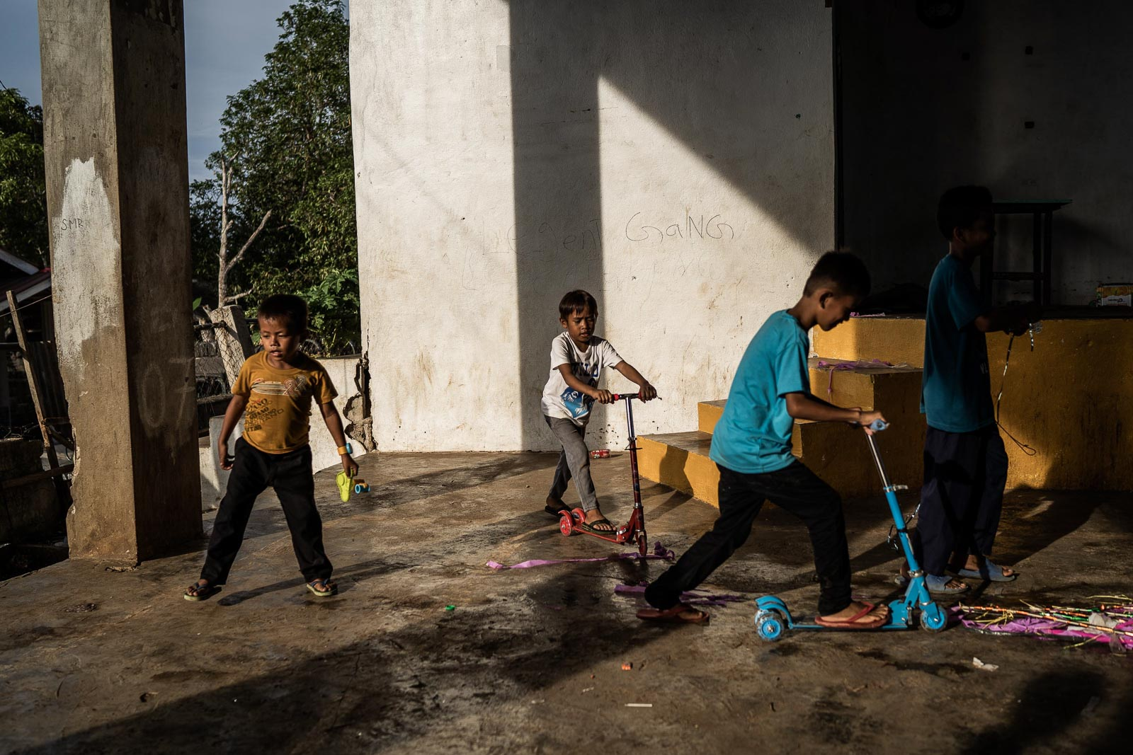 DEALING WITH TRAUMA. Children, some sons of rebel fighters, play with gifts in Basilan Island. Many of the ISIS fighters that came to Marawi in 2017, including its leader Isnilon Hapilon, were from this island. Photo by Martin San Diego