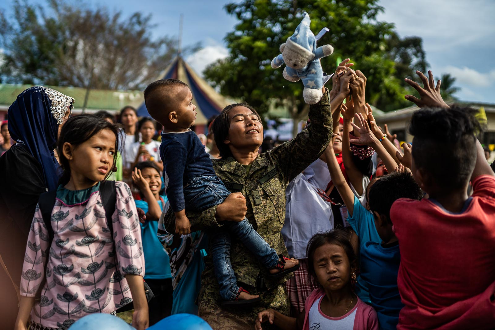 NEW REALITY. A soldier catches a stuffed toy for a child during the Festival of Love and Peace in Mohammad Ajul, Basilan, on October 4, 2019.  Photo by Martin San Diego